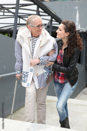 Girl helping older lady