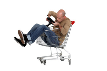Man sat in trolley with toy steering wheel