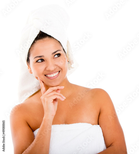 Thoughtful woman in towel
