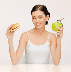 woman with hamburger and apple
