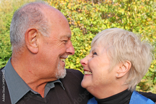 Beautiful senior couple laughing at each other
