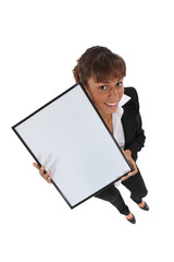 Office worker holding empty picture frame