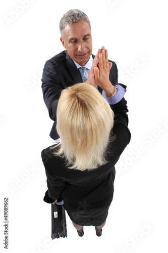 Business partners giving each other a high-five