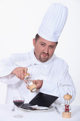 Chef getting ready to eat a laptop