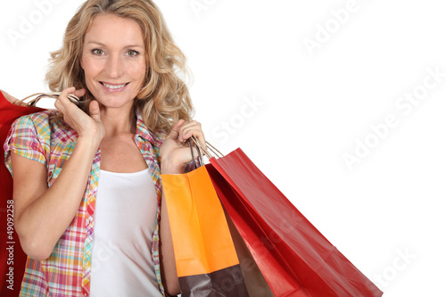 Woman with numerous shopping bags