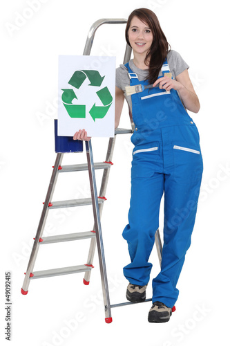 Decorator holding a recycle symbol