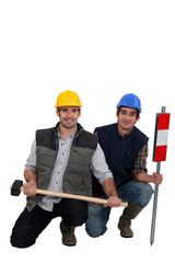 duo of workman posing in studio