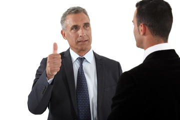 mature businessman thumb up with businesspartner