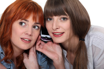 Two women on mobile telephone