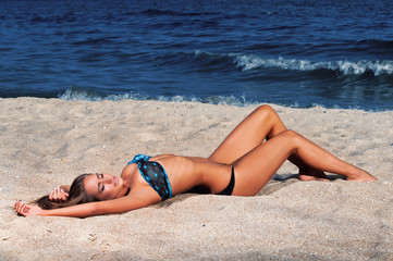 Beautiful young woman relaxing near the sea