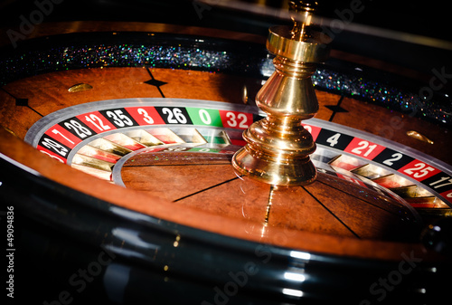 Close up of wooden roulette at the gambling house