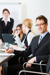Business - businesspeople, meeting and presentation in office