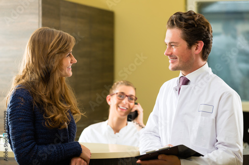 Woman and doctor at reception of clinic