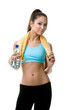 Athletic woman with bottle of water and yellow towel