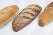 Selection of bread loaves on white