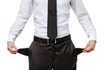 Broke business man with empty pockets, isolated on white