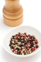 Colorful Peppercorns and Peppermill