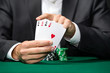 Gambler shows poker cards 4 aces
