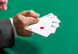 Gambler shows poker cards 4 aces. Addiction to the gambling