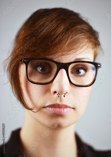 Piercing and Nerd Glasses on Woman