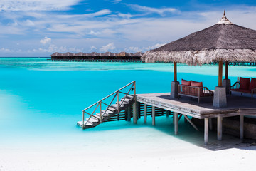 Over water jetty with steps into tropical lagoon