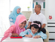 indonesian malay family doing homework together, quality time