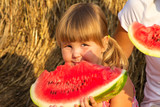 Girl eats red tasty water-melon