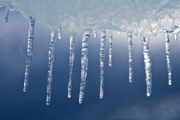 Beautiful icicles against the storm sky