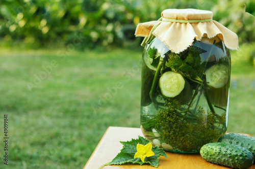Homemade cucumber preserved in glass jar