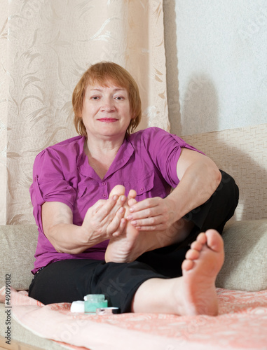 woman caring for the nails on feet