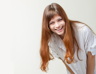 A smiling girl in a studio