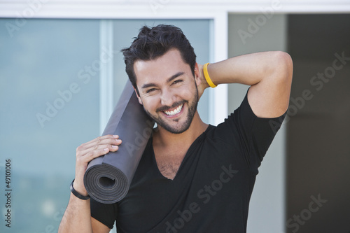 Portrait of a man holding yoga