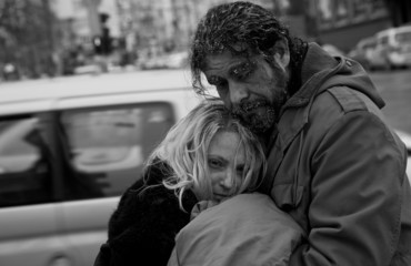 b/w homeless couple embracing