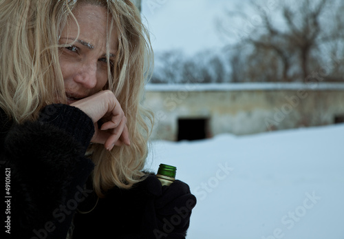 Homeless frozen woman alcohol bottle