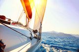 Fototapety Yacht Sailing against sunset. Sailboat. Yachting. Sailing