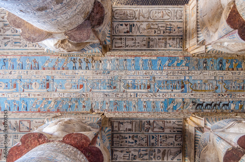 Ancient Egyptian hieroglyphs and carved paintings in Dendera