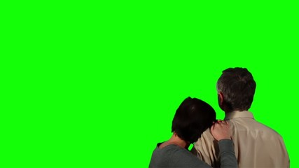 Happy couple over green screen