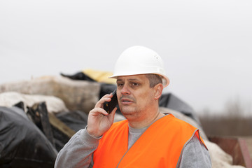 Worker talking on the phone to a container