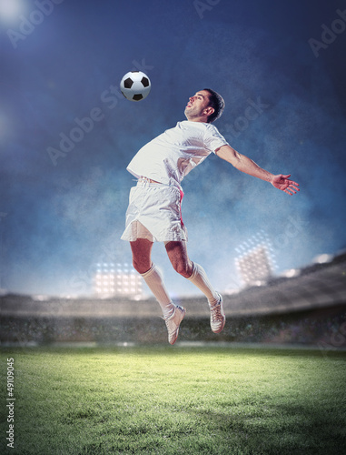 Foto op Aluminium Voetbal football player striking the ball