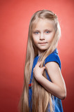 Beautiful blonde little girl with long hairs poster