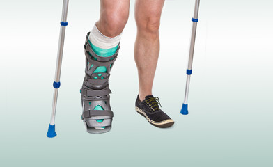 Man with a broken leg and  Crutches