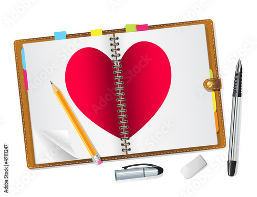 open diary with a red heart