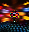 Colorful disco ball rotating light spot reflections on wall