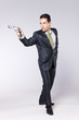 Businessman pointing a handgun