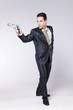 Businessman pointing a handgun
