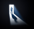 Man walking out into light