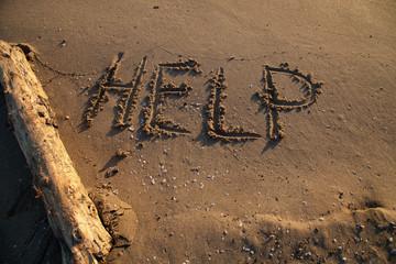 Messaggio di aiuto sulla spiaggia