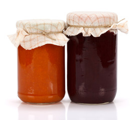 Plum and peach jam in glass jar