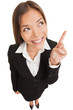 Business woman pointing showing and looking