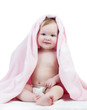 Adorable happy baby girl in towel